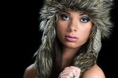 Pretty girl with fur hat Stock Photos