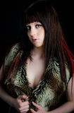 Pretty girl with fur vest and very much cleveage Stock Photography