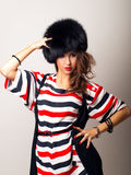 Pretty girl in furhat Stock Photos