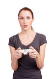 Pretty girl with gamepad playing Stock Photo