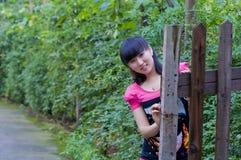 A pretty girl in garden Stock Photography