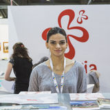 Pretty girl in the Georgian stand at Bit 2015, international tourism exchange in Milan, Italy Stock Photo