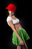 Pretty girl in german style dress with red hat Stock Photo