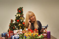 Pretty girl gets jewellry for christmas gift and smiles Stock Image