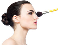 Pretty girl getting makeup applied on her face Royalty Free Stock Images