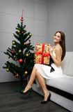 Pretty girl with gift Stock Photography