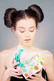 Pretty Girl with Gift Box. Surprised Model Stock Images