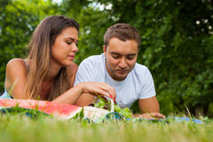 Pretty girl gives cherry to her boyfriend. She feeds him Stock Photos