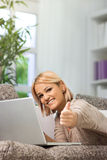 Pretty girl giving like on social network Royalty Free Stock Image