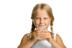 The pretty girl with a glass of milk Stock Images