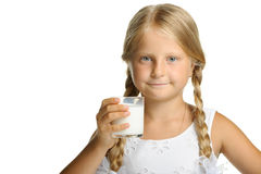 The pretty girl with a glass of milk Stock Photography