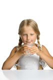 The pretty girl with a glass of milk Royalty Free Stock Photos