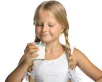 The pretty girl with a glass of milk Royalty Free Stock Images