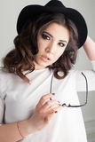 Pretty girl with glasses and hat. 1 Royalty Free Stock Image