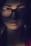 Pretty girl in glasses in shadows lines Royalty Free Stock Images