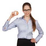 Pretty girl in glasses shows egg Royalty Free Stock Photography