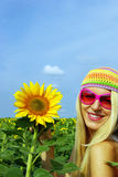 Pretty girl in glasses with a sunflower Royalty Free Stock Photo