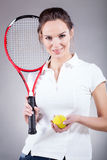 Pretty girl going for tennis Stock Images