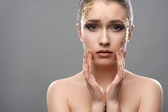 Pretty girl with golden make-up art Stock Image