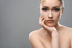 Pretty girl with golden make-up art Royalty Free Stock Images