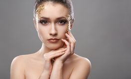 Pretty girl with golden make-up art Royalty Free Stock Photo