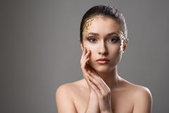Pretty girl with golden make-up art Royalty Free Stock Image