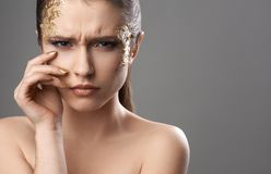 Pretty girl with golden make-up art Royalty Free Stock Photography
