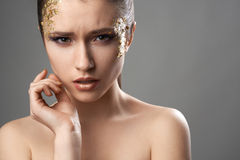 Pretty girl with golden make-up art Royalty Free Stock Photos