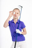 Pretty girl golfer on white backgroud in studio. Pretty girl golfer posing with golf club on white backgroud in studio Stock Photography