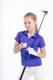 Pretty girl golfer on white backgroud in studio. Pretty girl golfer posing with golf club on white backgroud in studio Royalty Free Stock Images