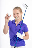 Pretty girl golfer on white backgroud in studio Royalty Free Stock Photos