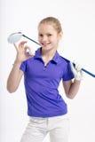 Pretty girl golfer on white backgroud in studio Royalty Free Stock Photos