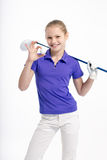 Pretty girl golfer on white backgroud in studio. Pretty girl golfer posing with golf club and ball on white backgroud in studio Royalty Free Stock Photography