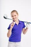 Pretty girl golfer on white backgroud in studio Royalty Free Stock Images