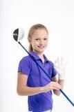Pretty girl golfer on white backgroud in studio Stock Photo