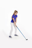 Pretty girl golfer on white backgroud in studio Stock Images