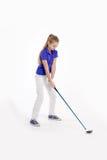 Pretty girl golfer on white backgroud in studio. Pretty girl golfer swinging with diver on white backgroud in studio Stock Images