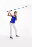 Pretty girl golfer on white backgroud in studio Royalty Free Stock Photography
