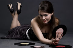Pretty girl with gramophone record Stock Photo