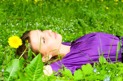 Pretty girl on the grass Royalty Free Stock Images