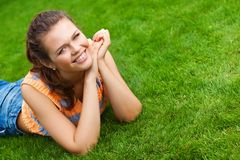 Pretty girl on grass Stock Image