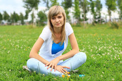 Pretty girl on grass Stock Images