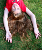 Pretty Girl on Grass. Smiling young girl on fresh green grass Royalty Free Stock Photography