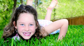 Pretty girl in grass Stock Image