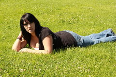 Pretty Girl On The Grass. Pretty girl relaxing at the city park Royalty Free Stock Photography