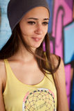 Pretty girl with gray hat Stock Photography