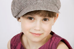 Pretty girl in a gray woolen cap Stock Image