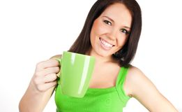 Pretty girl with a green cup Royalty Free Stock Photos