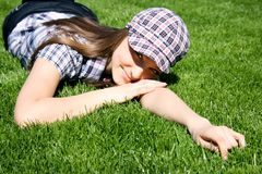 Pretty girl on the green grass Royalty Free Stock Photo