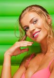 Pretty girl with green mattress Royalty Free Stock Images